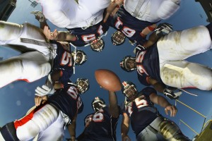 Football Team in a Huddle